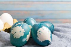 Happy easter, organic blue easter eggs, easter holiday decorations, easter concept backgrounds with copy space Stock Image