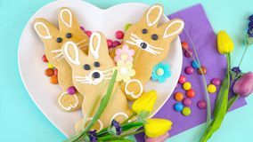 Happy Easter overhead with Easter Bunny cookies and decorations Stock Photos