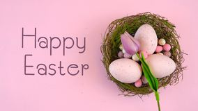 Happy Easter overhead with Easter eggs and decorations with animated text. stock footage