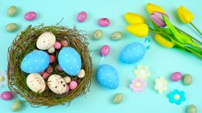 Happy Easter overhead with Easter eggs and decorations Stock Image