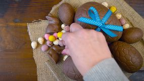 Happy Easter overhead with Easter eggs and decorations on a wood background. stock footage