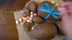 Happy Easter overhead with Easter eggs and decorations on a wood background. stock video