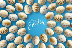 Happy Easter, painted Easter egg on a blue background. White gold pattern. royalty free stock images