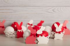 Happy Easter! Painted Easter eggs and Easter decoration - Easter bunnies with ribbons - red, white and red with white polka dots. Happy Easter! Painted Easter stock photos