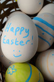 Happy Easter Painted Eggs in Basket Stock Photography