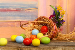 Happy Easter Painted Eggs Flowers Wicker Basket Stock Image