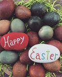 Happy Easter with painted stones and eggs Stock Image