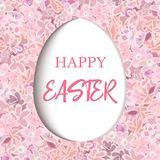 Happy Easter. paper cut Decorated white flat egg on pink flower background carnation, crane`s-bill or meadow geranium wildflower, Royalty Free Stock Photography