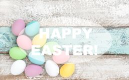 Happy Easter Pastel colored eggs decoration wooden background Stock Image