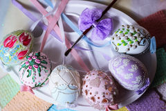 happy easter pastel easteregg table lace ribbon artistic brush painting eggs colorful Stock Photography