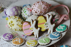 Happy easter pastel eastereggs bunny cookies table lace words alphabet greeting message. Holiday celebration cute pink plate spring wood stock image