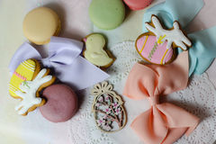 Happy easter pastel eastereggs bunny cookies table lace words alphabet greeting message ribbon. Holiday celebration cute pink plate spring wood stock photography