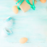 Happy Easter pastel green background eggs gift cups space Royalty Free Stock Images