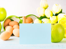 Happy Easter pastel green yellow background eggs tulips card Stock Images