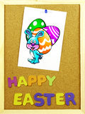 Happy Easter phrase on a corkboard Stock Photo