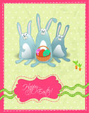 Happy Easter postcard with rabbits and basket Royalty Free Stock Photo
