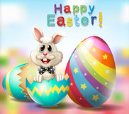 Happy Easter poster with bunny and rainbow eggs Stock Photos