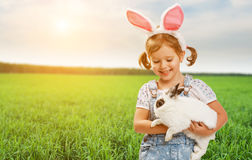 Happy easter! Pretty child girl with rabbit in nature. Happy easter! Pretty child girl with a rabbit in nature Stock Photography
