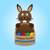 Happy easter rabbit with basket full of eggs Stock Photography