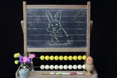 Happy Easter rabbit on blackboard Royalty Free Stock Images