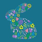 Happy easter rabbit brings beautiful flowers. An isolated image of Happy Easter rabbit silhouette filled with early spring flowers such as miscarry, tulips Stock Photos