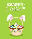Happy Easter rabbit in egg basket holiday card Stock Photo