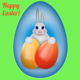Happy Easter.  Rabbit with multi-colored Easter eggs. Stock Photography