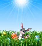 Happy easter rabbit out of holes in the ground with easter eggs in the grass background. Illustration of Happy easter rabbit out of holes in the ground with Stock Image