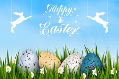 Happy Easter with realistic colorful decorated eggs, grass, spring flowers, easter bunny. Bright blue background. Design. Template for Banner, flyer, invitation Royalty Free Stock Image