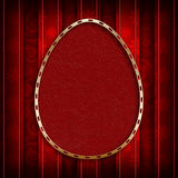 Happy Easter - red egg in golden frame on patterned background Royalty Free Stock Photo