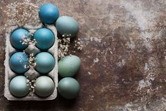 DIY dyed various shades of blue Easter eggs on retro rusty metal background. Happy Easter. Happy Easter rustic concept with copy space. DIY dyed various shades Royalty Free Stock Images