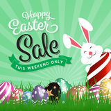 Happy Easter Sale Promotion. Painting Eggs Hidden on Green Grass With Easter Typographic Background. Vector illustration Stock Photo