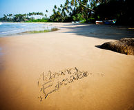 Happy Easter on the sandy beach by the ocean Stock Image