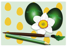 Happy Easter. Season - the daffodil with two green eggs Royalty Free Stock Photo