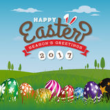Happy Easter Season`s Greeting Card 2017. Painting Eggs Hidden on Grass With Easter Typographic Background. Vector illustration Royalty Free Stock Photography