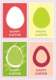 Happy Easter set of four simple design cards. With different colored eggs Stock Photos