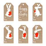 Happy Easter! Set of  tags with cute Easter bunny on kraft paper. Hand-drawn  set of tags with the symbols of Easter Royalty Free Stock Photo