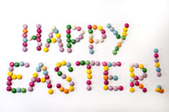 Happy Easter sign of the colored chocolate candies Royalty Free Stock Images
