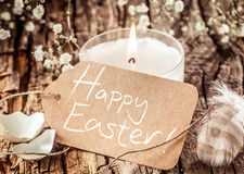 Happy Easter sign with egg shells and feather Royalty Free Stock Photography