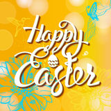 Happy Easter sign, symbol, logo on a  yellow background with the flowers. Stock Photo