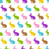 Happy Easter silhouettes - colorful bunnies - endless. Seamless easter background with pastel colored rabbits Royalty Free Stock Photo