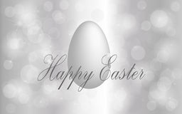 Happy Easter. Silver shining easter background with white egg Royalty Free Stock Photo