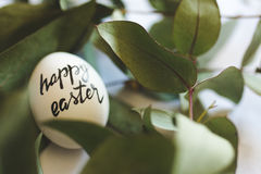 Happy easter stamp on the eggs Stock Photos