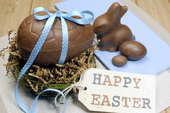 Happy Easter still life on blue and wood background. Royalty Free Stock Images