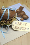 Happy Easter still life on blue and wood background - vertical with copy space. Stock Photos