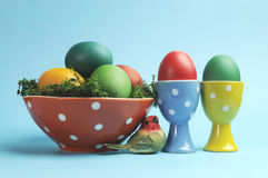 Happy Easter still life with polka dot cups and rainbow color eggs Stock Image