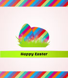 Happy easter with striped eggs in grass Stock Photo