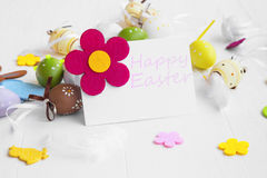 Happy Easter tag with easter eggs, flowers, bunnies and feathers Stock Photography