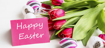 Happy Easter tag with spring tulips bouquet and Easter eggs deco. Ration Royalty Free Stock Photos