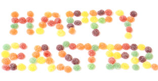 Happy easter text. In candy sweets isolated on a white background Royalty Free Stock Photos